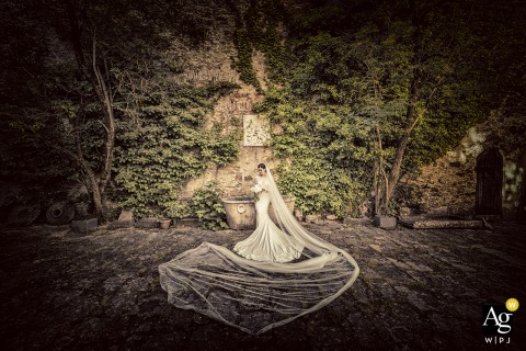 Castello di Fosdinovo Massa wedding bride artistic image session with the brides dress and veil spread out on the ground