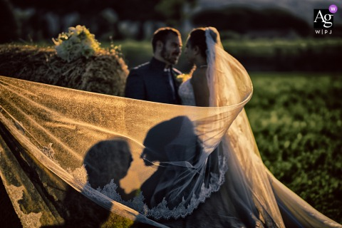 Versilia wedding couple artistic image session with shadows on the brides veil