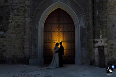 Iglesia de Santa María, Arjona, Jaén wedding couple artistic image session under the arch of the church doors