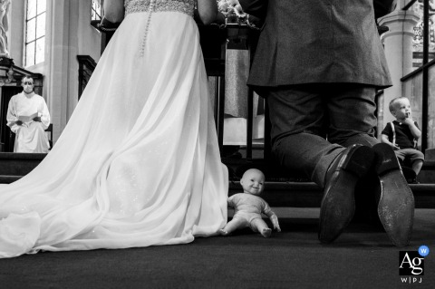 Flanders artful style wedding detail picture from inside the church with a doll in a triangle