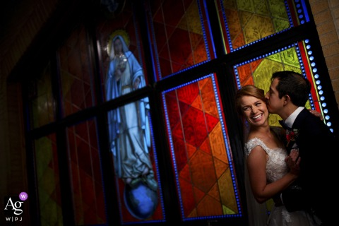 Colorado wedding couple portrait artistic image session with stained glass inside the Holy Name Catholic Church