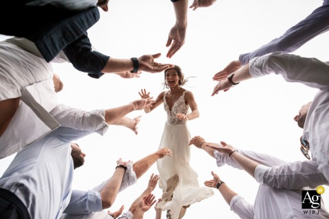 Chateau du Vergnet, Tarn, France wedding bride artistic image session with Bride having fun while the boys make her jump