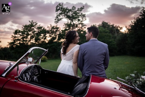 Domaine les tables de Crespin, Tarn, France wedding couple artistic image session from the south of France as The bride and the groom sit next to old car are enjoying the Sunset