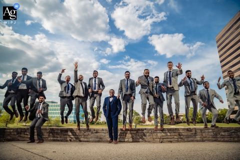 Westin, Itasca, IL wedding party artistic image session with a groomsmen jump
