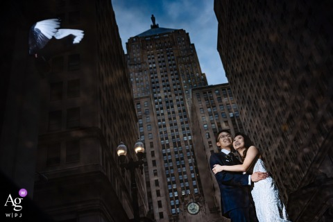 Board of Trade, Chicago wedding artistic image session for a couple reflected in a puddle in front of the board of trade building