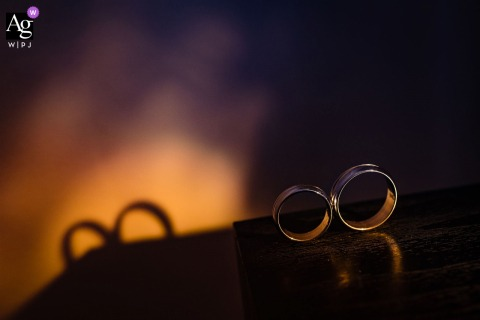 Sofia, Bulgaria artful style wedding detail picture showing the couples wedding rings and their shadows