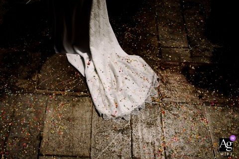 Mairie de Sète artful style wedding detail picture of the brides dress covered in confetti