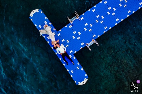 Bodrum Turkey wedding couple artistic drone picture session with a couple lying on the pier