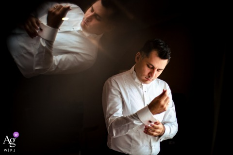 Istanbul Divan Hotel wedding groom artistic image session for a Groom getting ready and his reflection is produced by a glass prism