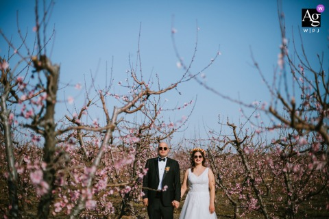 Bodrum, Turkey wedding artistic image session for a Couple posing in a peach garden