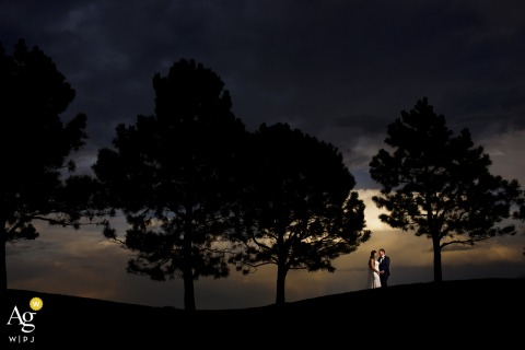Sanctuary Golf Course wedding couple artistic image session with a bride and groom pose together at sunset under a tree