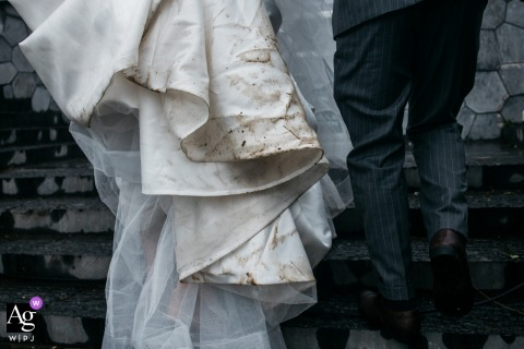 Guangdong artful style wedding detail picture at the outdoor Reception Venue showing Not so good weather getting brides dress dirty