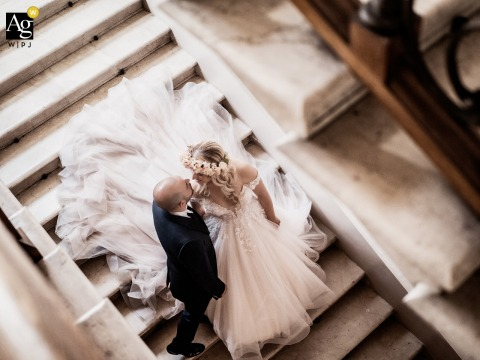 Villa Lattuada, Italy wedding couple artistic image session with a feeling that the observer spies on this couple while going down the steps of the villa that hosts them, he pauses for a moment of intimacy