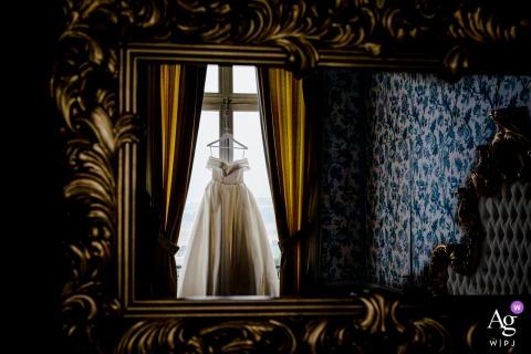 Chateau de Dangu, France artful style wedding detail picture highlighting the brides Wedding dress