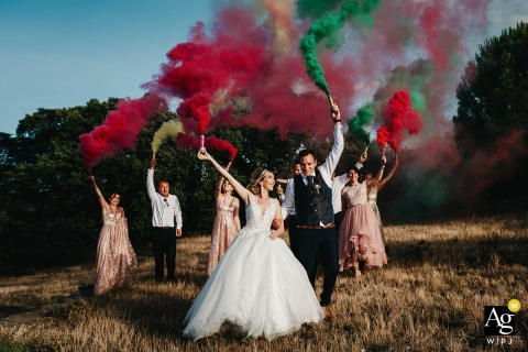Pyrénées-Orientales, France wedding bridal party artistic image session showing smoke grenades and the Bride and groom with bridal party