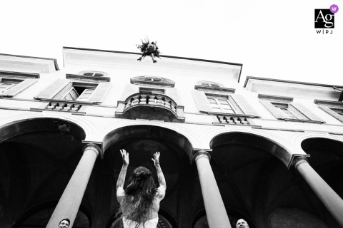Villa Gromo artful style wedding detail picture in BW of the bride tossing her Bouquet