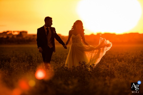Tenuta Pantano Borghese, Rome, Italy wedding couple artistic image session resulting in a Portrait of the bride and the groom at sunset