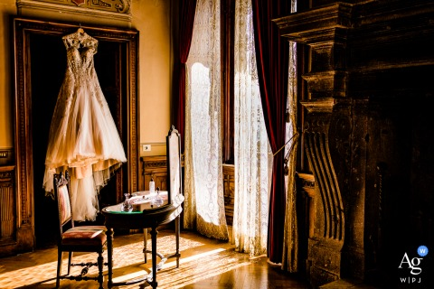 Castello di torre Alfina, Italy artful style wedding detail picture showing The wedding dress in a really famous villa