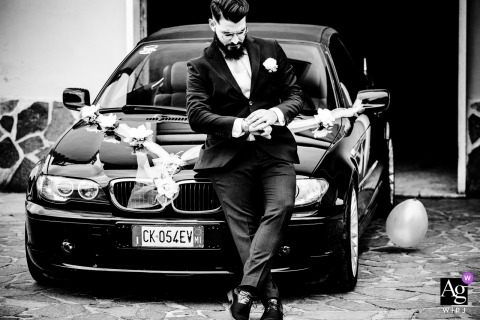 Rome, Italy wedding groom artistic image session resulting in a BW Portrait of the groom with his car