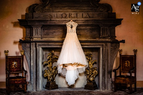Castello di Torre Alfina, Italy artful style wedding detail picture of The wedding dress in a really old and famous Italian villa