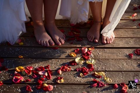 Leblon São João, Costa da Caparica, Lisbon, Portugal artful style wedding detail picture of Brides foots near the rose petals