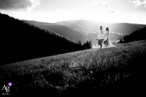 Beskydy wedding couple artistic image session in BW of the Couple walking the mountain meadow