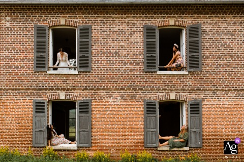 Île-de-France wedding bridal party artistic image session at the Reception venue of The brides team on different windows