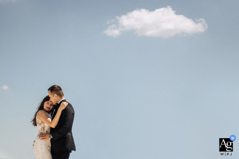 Osadnik Gajowka wedding couple artistic image session resulting in a Portrait of the bride and groom against the blue sky