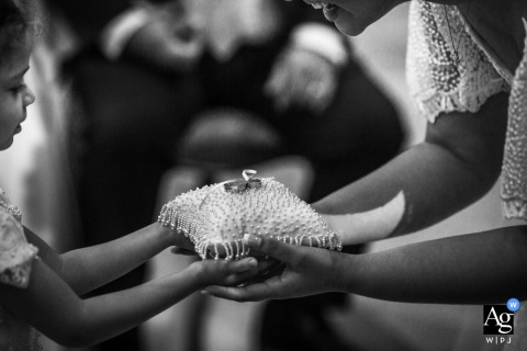 Capela Medalha Milagrosa artful style wedding detail picture of the rings being passed to the bride on a pillow