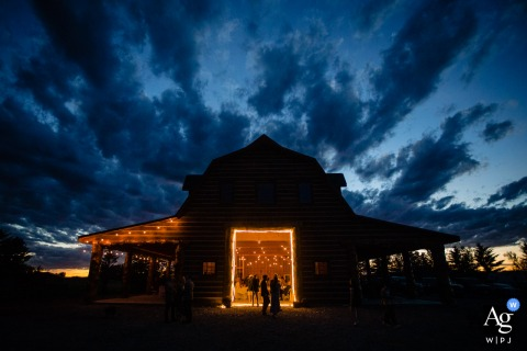 Montana wedding barn venue reception photography during the blue hour with indoor lighting showing off