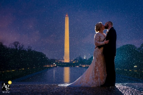 The Lincoln Memorial, Washington DC wedding couple artistic image session as Newlyweds passionately kiss in the rain at dusk
