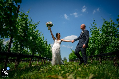 Stone Tower Winery, Virginia wedding couple artistic image session with a bride and groom dancing through a vineyard