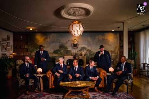 Marriott Metro Center, Washington DC wedding party artistic image session of the Groomsmen enjoying conversation together in an ornate room