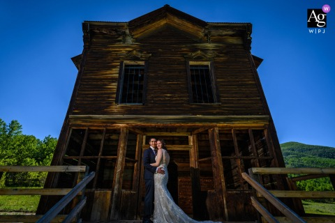 Aspen, Colorado wedding couple artistic image session standing in front of an abandoned old building in a ghost town