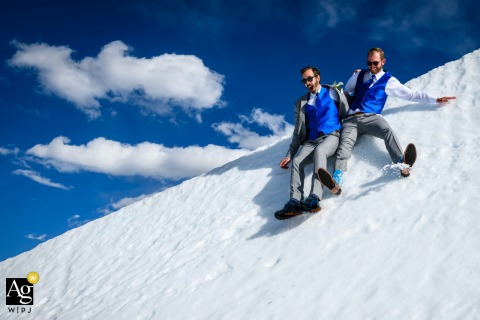 Aspen, Colorado artistic image session with the groom and best man slide down the side of snowboarding halfpipe