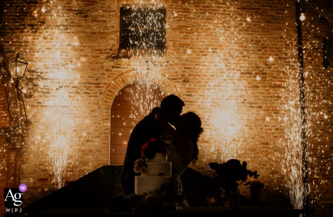 View thisdramatic Poggio Berni, Rimini, Italy wedding pic showing a kiss in silhouette with the fireworks in the background, which was a featured pictureamong the best wedding photography at Palazzo Marcosanti from the WPJA