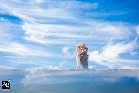 View thispicturesque Siracusa bride and groom shooting pic session in the clouds, which was a featured pictureamong the best wedding photography in Italy from the WPJA