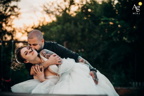 View thissensitive Sofia wedding day Sunset portrait of couple with tattoos, which was a featured pictureamong the best wedding photography in Bulgaria from the WPJA