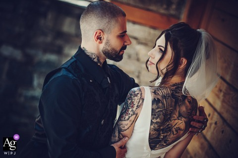 View thispoetic Sofia wedding image of bride and groom with tattoos, which was a featured pictureamong the best wedding photography in Bulgaria from the WPJA