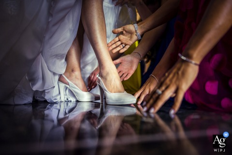 View thisstylish Genoa wedding image of friends helping the bride, which was a featured pictureamong the best wedding photography at Villa Sorgiva from the WPJA