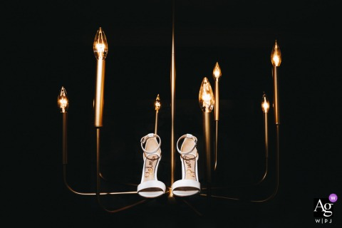 View thisstylish Ohio wedding image of the brides Shoes at home with cool lights, which was a featured pictureamong the best wedding photography from the WPJA