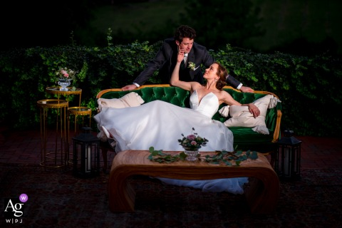 View thisdramatic Poplar Springs Manor dramatic seated wedding couple portrait on a vintage sofa which was a featured pictureamong the best wedding photography in Warrenton, VA from the WPJA