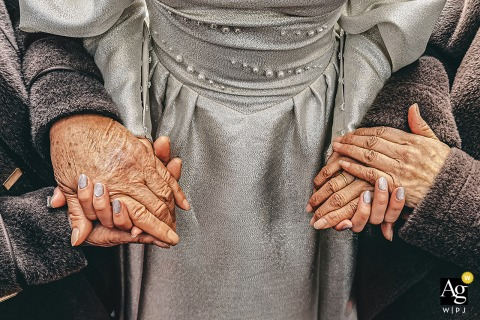 View thispoetic Wenzhou wedding image of the Bride and two grandmas holding hands, which was a featured pictureamong the best wedding photography in Zhejiang from the WPJA