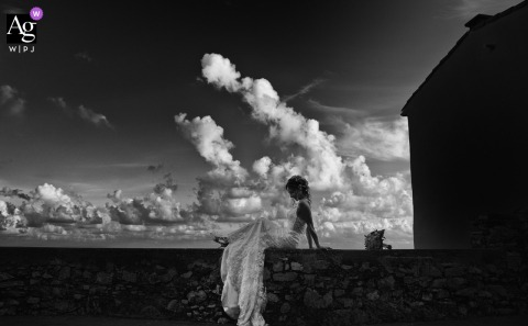 View thisstylish Tellaro wedding image of the bride to infinity with clouds, which was a featured pictureamong the best wedding photography in La Spezia from the WPJA