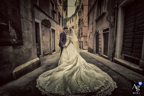 View thiscreative Duomo di Carrara wedding portrait in the historic center in warm tones, which was a featured pictureamong the best wedding photography in Italy from the WPJA