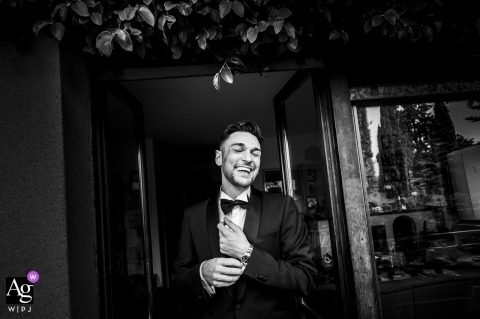 View thistasteful Abbadia Lariana image in BW showing the groom is happy, which was a featured pictureamong the best wedding photography in Italy from the WPJA