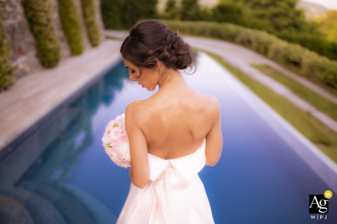View thisstylish Villa Calchi portrait of bride at the swimming pool, which was a featured pictureamong the best wedding photography from the WPJA