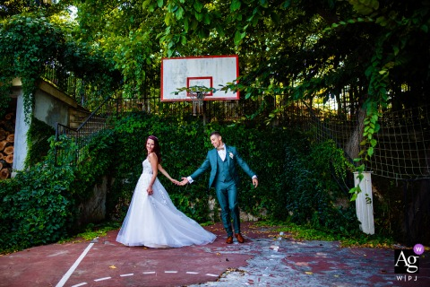 View thisgraceful Goliama Zelezna image of The wedding photoshoot on the basketball playground, which was a featured pictureamong the best wedding photography at Raiski Zaliv in Bulgaria from the WPJA