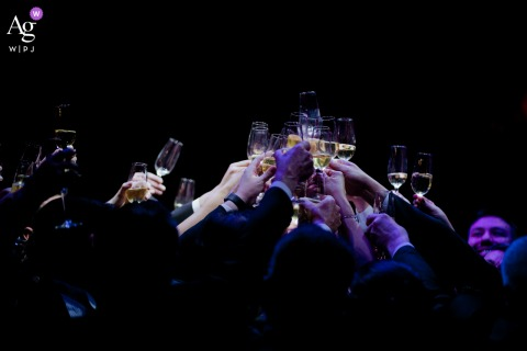 View thisdramatic Allegro Buffet wedding image of a toast with purple lighting, which was a featured pictureamong the best wedding photography in Brazil from the WPJA