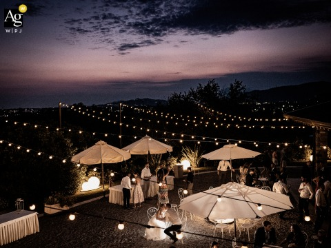 View thisdecorative La Collina dei Desideri wedding image of a newly married couple at the end of the reception on the hill of wishes, which was a featured pictureamong the best wedding photography in Bergamo, Italy from the WPJA